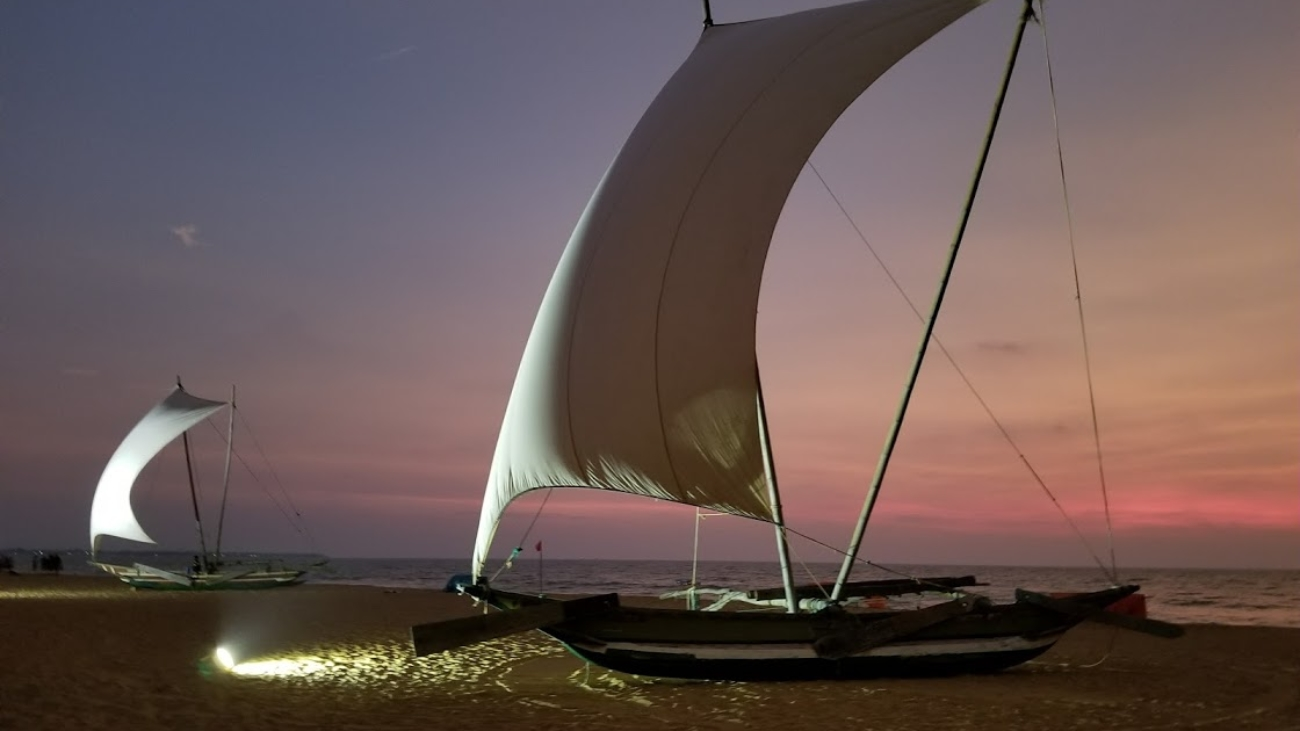 CATERMARAN ON THE BEACH